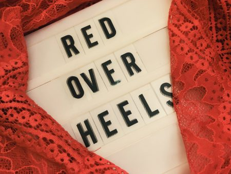 Red over heels light board with red dress
